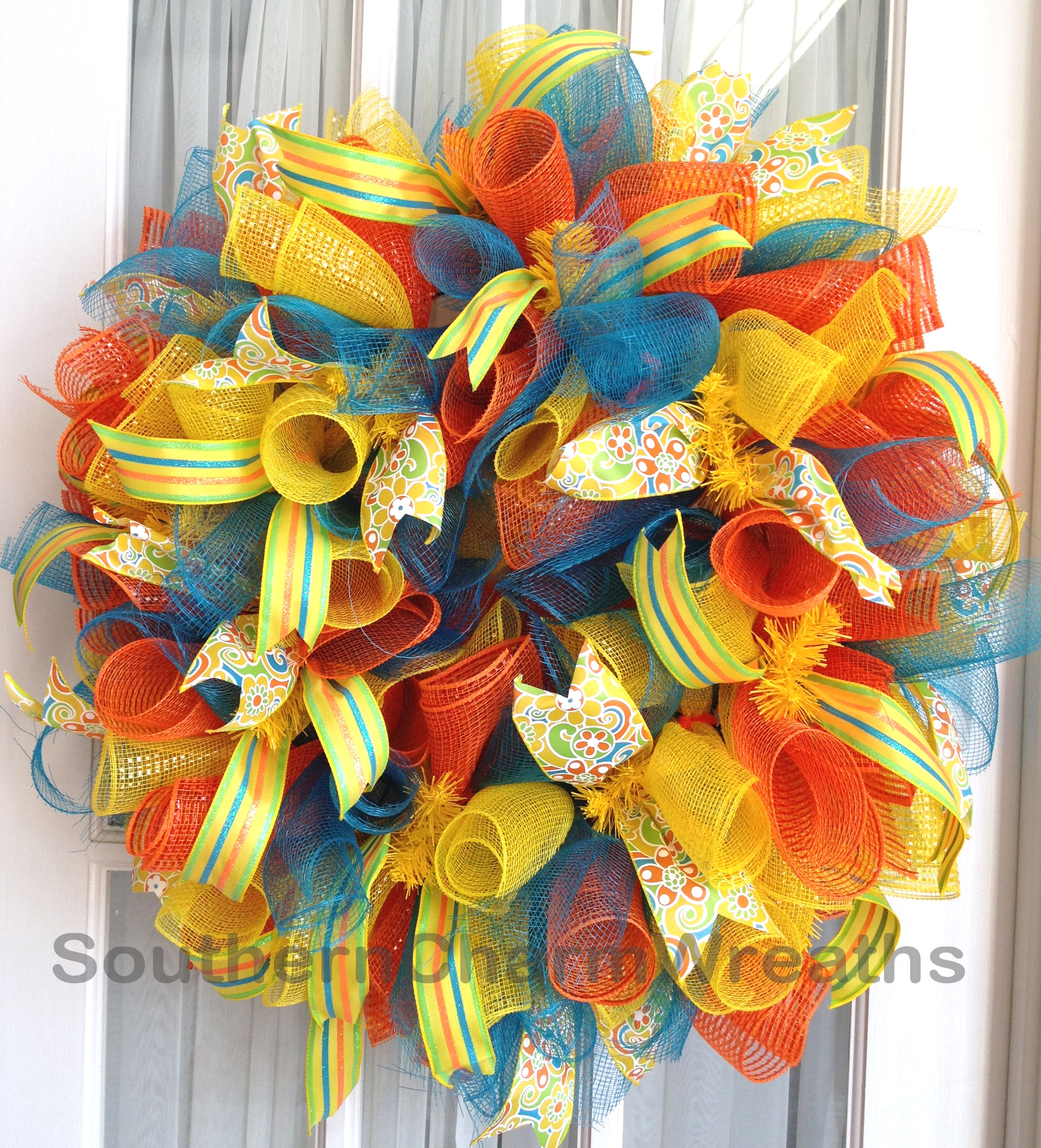 curly--deco-mesh-wreath-orange-yellow-turquoise-2a